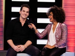 Tom Plant talks game with host Arisa Cox shortly after his eviction.