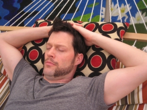 Andrew tries to get some R&R and mentally escape the game, laying on the hammock in the backyard.