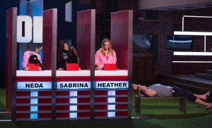 Neda, Sabrina, and Heather compete in HOH; Jon watches on.  Photo by Greg Henkenhaf
